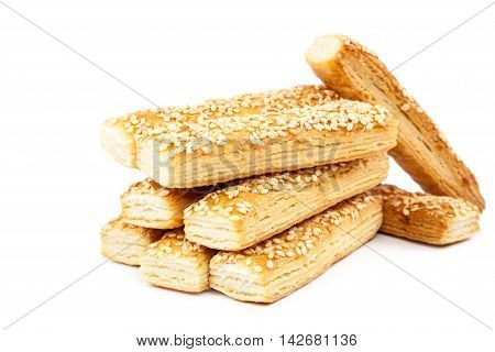 Puff biscuits with sesame seeds isolated on white background.