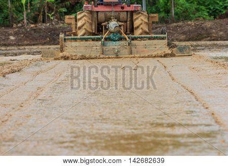 Tractor plowing farm field in preparation for season planting