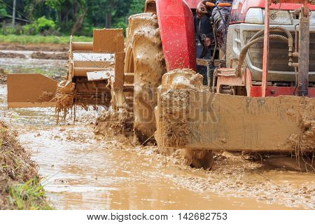 Tractor plowing farm field in preparation for season planting