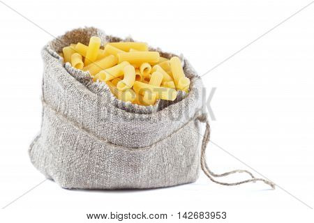 Sack with pasta isolated on white background.