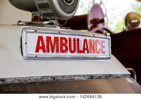 Photograph of a retro red ambulance sign