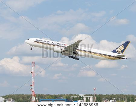 The Moscow region - 31 July 2016: Powerful Airliner Boeing 777-312ER Singapore Airlines taking off at the airport Domodedovo 31 July 2016 Moscow region Russia