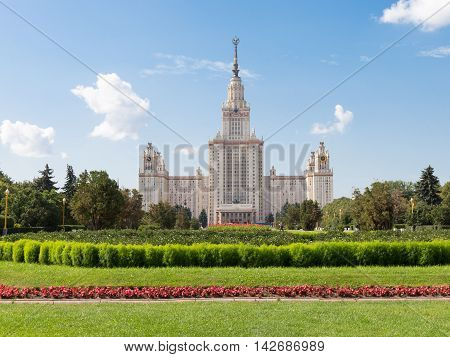 Moscow - August 11 2016: Beautiful Moscow State University named after Lomonosov on the Sparrow Hills and flowerbeds and the lawn in the foreground August 11 2016 Moscow Russia