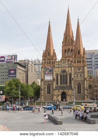 Melbourne - February 23 2016: View of the Cathedral of St. Paul the view from Federation Square and people walk in summer February 23 2016 Melbourne Australia