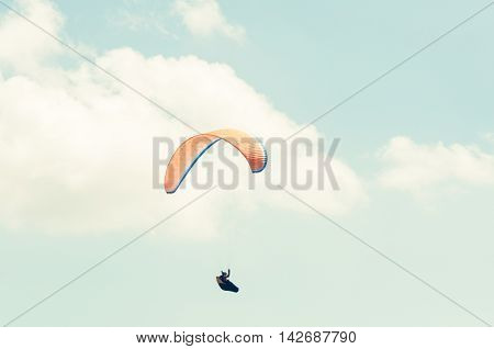 One Paraglider On A Summer Blue Sky