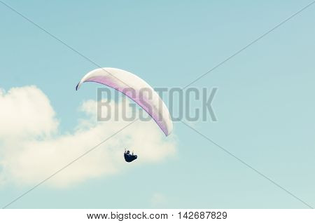 Paragliding In The Blue Sky On Sunny Day