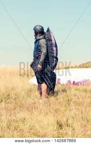 Male Paraglider Waiting To Take Off