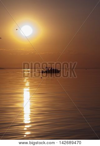 Photo fishing trip at sunset from a boat