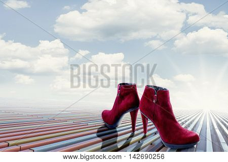 Red Colored Pair Of High Heels Standing On A Platform