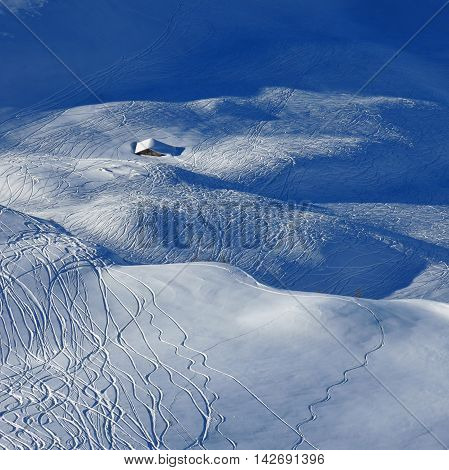 Winter scene in Stoos Swiss Alps. Ski and snowboard tracks in powder snow.
