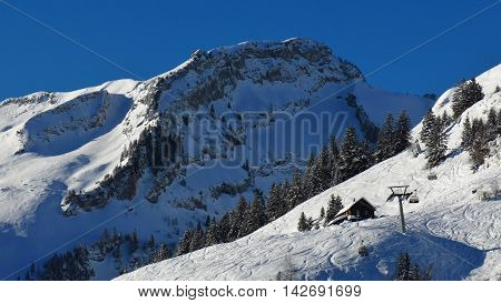 Mt Huser Stock and ski slopes. Winter scene in Stoos Swiss Alps.
