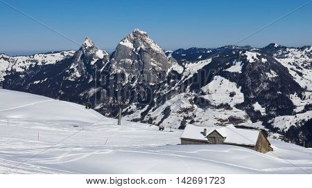 Winter landscape in the Swiss Alps. Ski area Stoos. View of Mt Mythen.