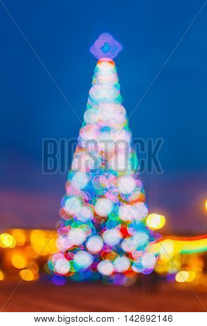 Abstract Defocused Blue Bokeh Background Effect. Design Backdrop. New Year Boke Lights Xmas Christmas Tree And Festive Illumination