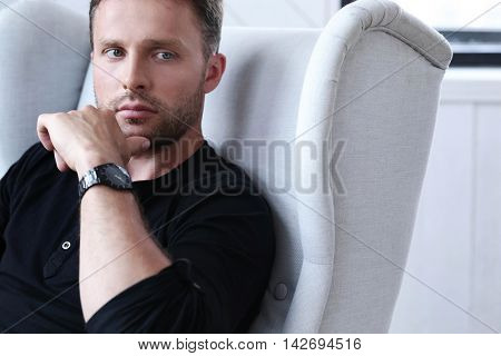 Handsome man sitting in the chair