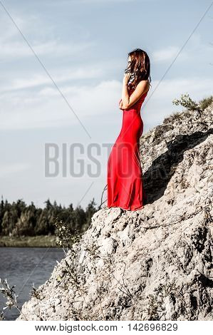 Lady In A Red Dress On The River Edge