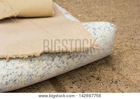Old pieces of rolled up carpet and underlay