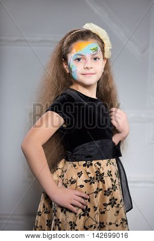 Girl Posing With A Pattern On Her Face