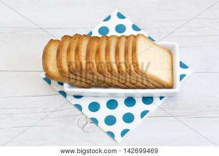 Group Of Rusks On A White Platter