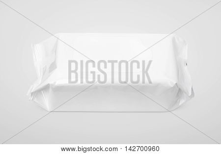 Wet wipes white package with flap on gray background with clipping path