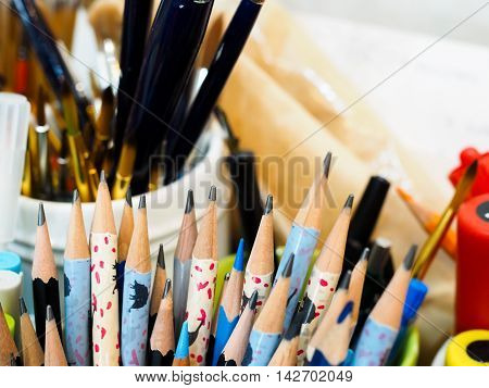 Many Pencils In The Cup On Untidy Table