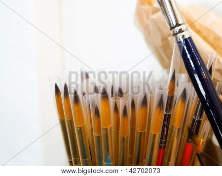 Unused Paint Brushes Pile In The Cup With Copy Space