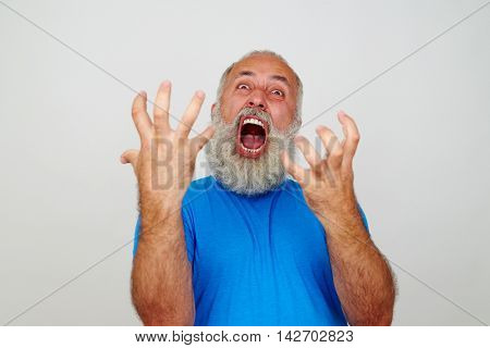 Expressive bearded man is gesturing nervous crisis isolated on white