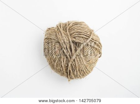 Hank of natural rope on white background. Gray