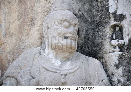 Ancient Buddha and buddhist god carvings and caves with longmen grottoes in Luoyang China in Henan Province.