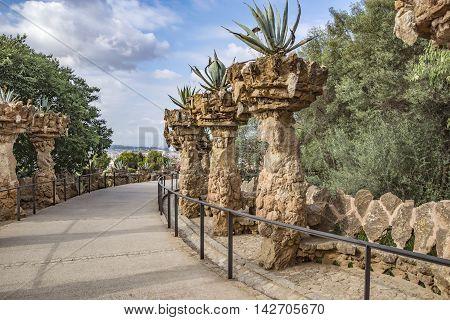 BARCELONA SPAIN - JULY 3 2016: Pedestrian road in park Guell in Barcelona Spain