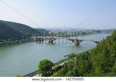 The Longmen Bridge over the Yi River at Longmen Grottoes in Luoyang China in Henan Province.