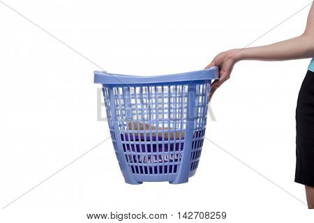 Hands holding the basket with dirty laundry