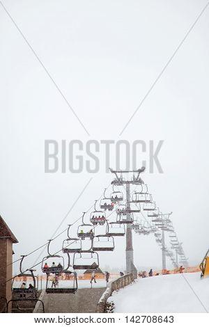 Ski lift chairs on cold winter day. Carpatians Ukraine