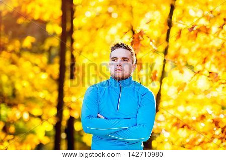 Young Handsome Hipster Runner Outside In Sunny Autumn Nature