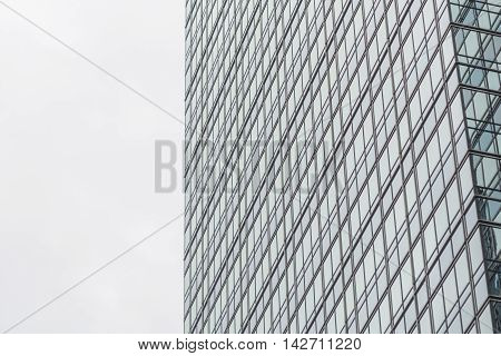 Glass windows pattern on the building with bright sky in sunny day.