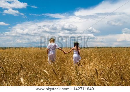 mother and daughter in the wheat field