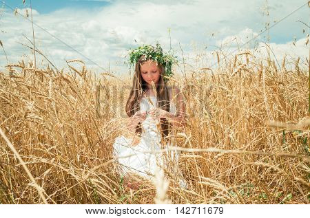 little girl in the wheat field in summer