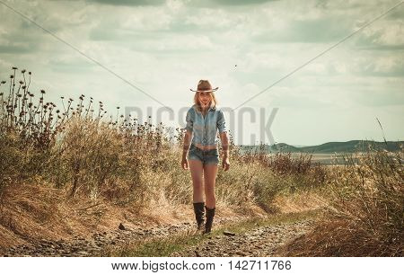 pretty woman in cowboy hat outdoors in farm