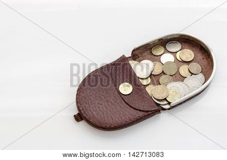 leather purse with Polish coins on white background