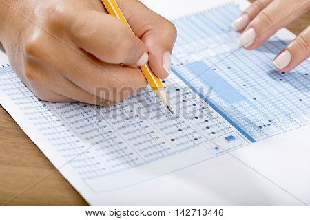 Filling answers of multiple choice examination close up.