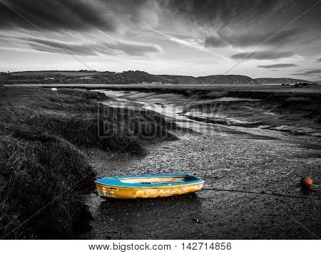 Boat on the Estuary at Sunrise. Laugharne, Carmarthenshire, Wales
