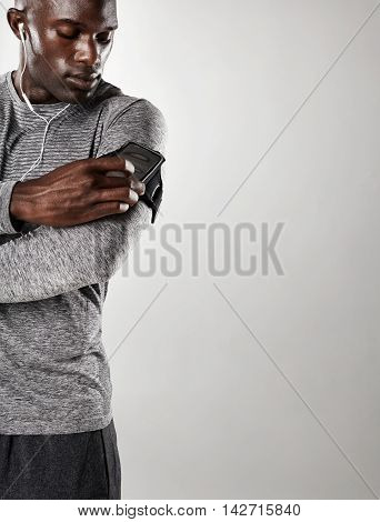Young Black Male Model Listening To Music On Cell Phone