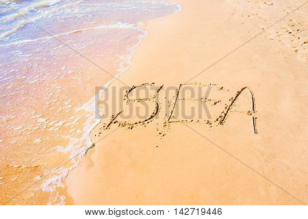 Written sea on sand at the coast abstract marine background
