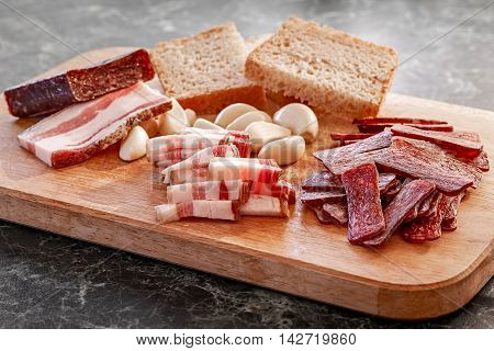 Traditional armenian smoked sausage sudzhuk with salty bacon garlic and bread