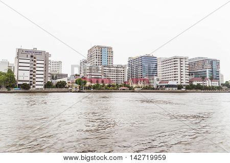 Bangkok, Thailand - June 5, 2016: Siriraj Hospital view from the other side of Chao Phraya River on cloudy day. It is the oldest and the most famous hospital in Thailand and part of Mahidol university