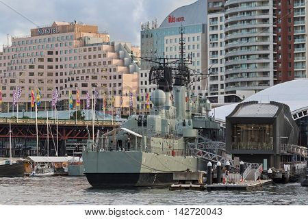 SYDNEY, AUSTRALIA - APRIL, 2016 : Australian Daring-class destroyer HMAS Vampire and other ships docking at Darling Harbour with Pyrmont Bridge in background, Sydney, Australia on April 21, 2016.