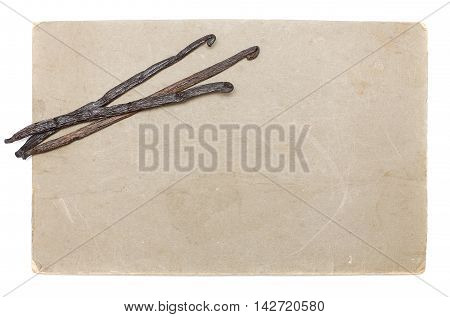 Old paper with vanilla beans isolated on white background