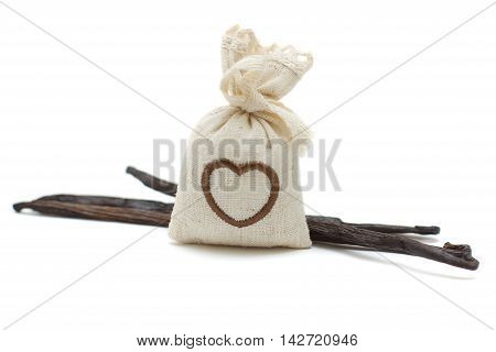 Vanilla beans and bag of aroma herbs