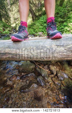 girl hiking boots on woof bridge