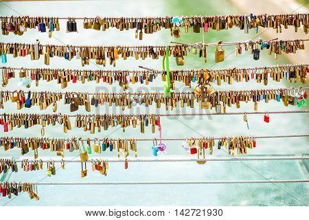 Ljubljana, Slovenia - May 6, 2016: Padlocks hanging on Mesarski bridge on Ljubljanica river in Slovenia