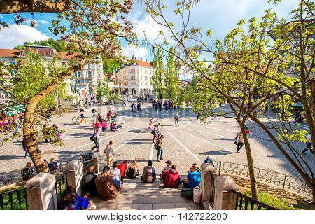 Ljubljana, Slovenia - May 6, 2016: Preseren square with people walk and sit in the centre of Ljubljana city in Slovenia. Ljubljana is the capital of Slovenia and famous european tourist destination.